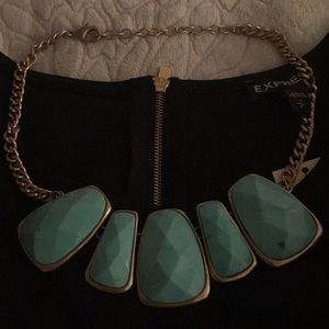 Turquoise necklace with light gold chain. 20""
